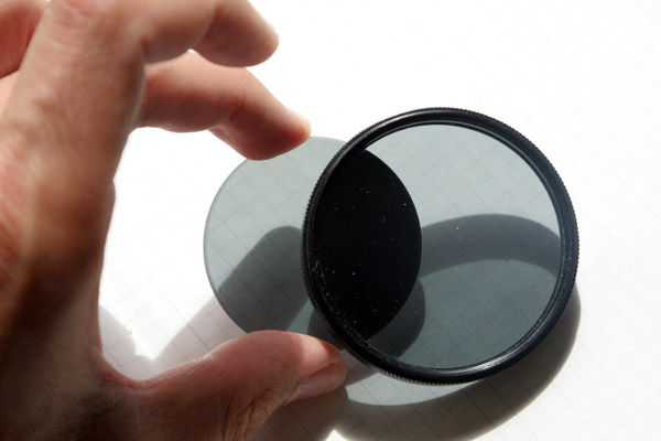 When the polarizing filters are turned into a crossed position, then they will not allow light to go through. This is the position used for microscopy.